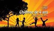 Royalty-free people stock photo of four silhouetted children running, holding hands and doing somersaults in a field near a tree, against a bursting orange sunset.